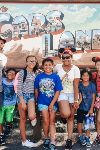 Multiracial family posing at Disney California Adventure